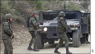 _1250411_troops300.jpg